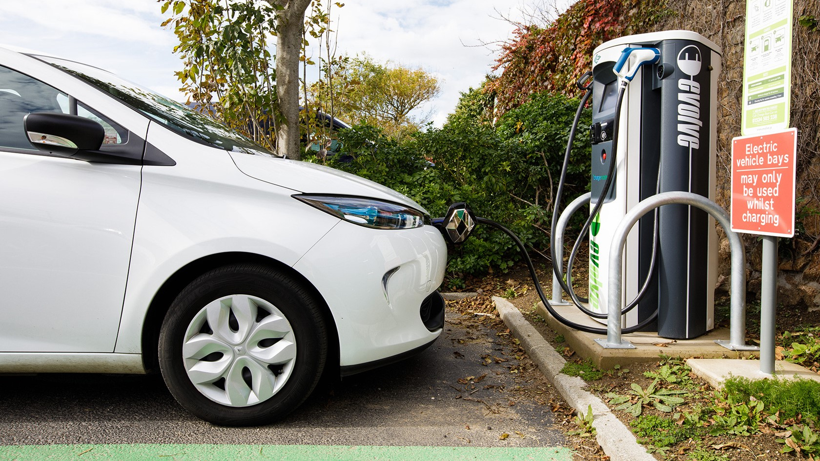 An electric vehicle charges at Red Houses in St Brelades.