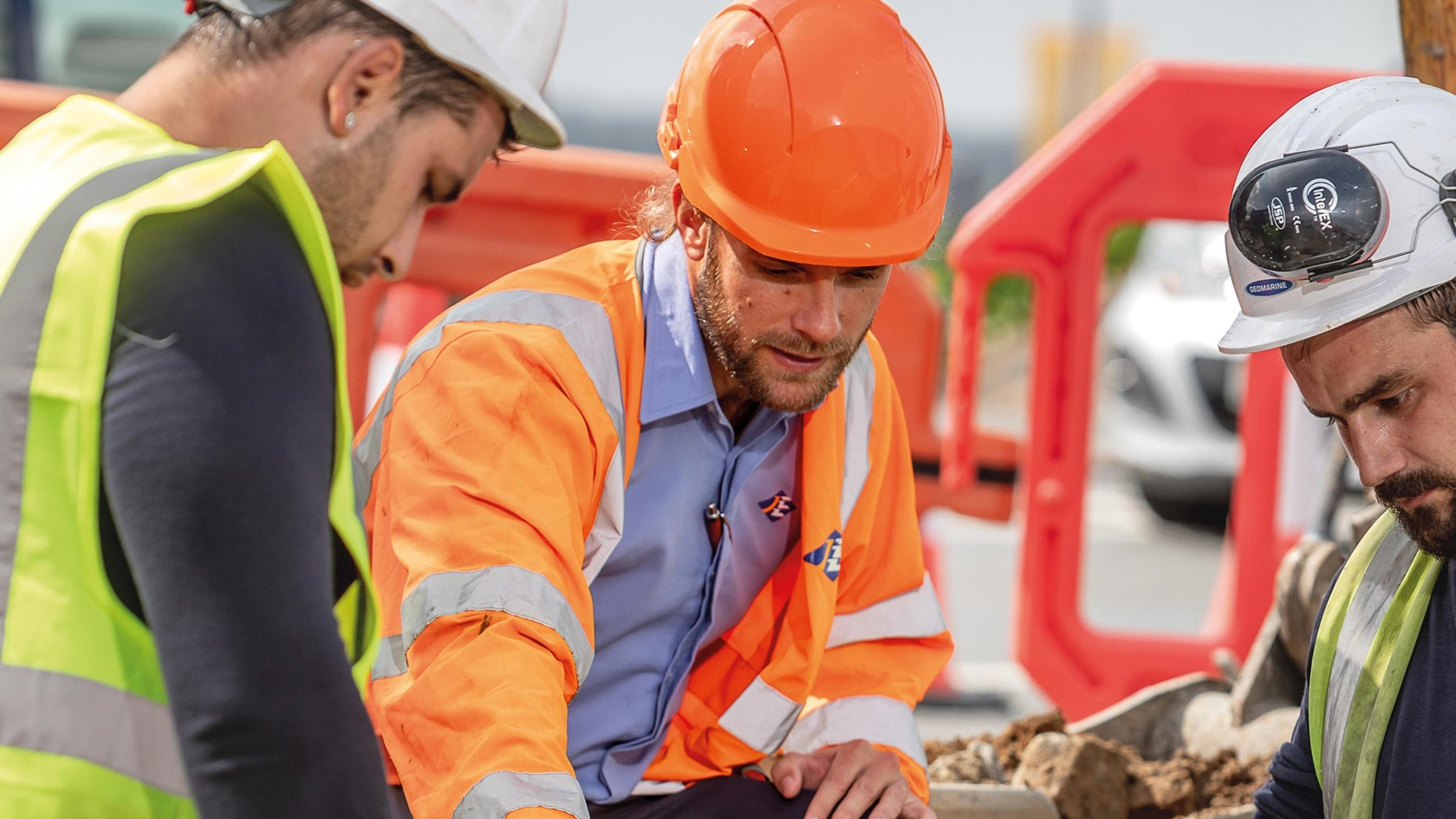 Sam Boleat gives advice to contractors during a constriction project.